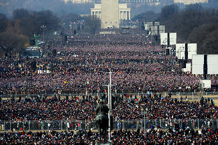 Thousands of people crowd the Mall in Washington, DC hours before Barack Obama is sworn in as the 44th US president by Supreme Court Chief Justice John Roberts in front of the US Capitol on January 20, 2009.       AFP PHOTO/Stan HONDA (Photo credit should read STAN HONDA/AFP/Getty Images)   Original Filename: Was2128303.jpg