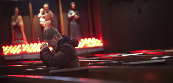 A man prays during Ash Wednesday Mass at St. Andrew's Church in the Manhattan borough of New York March 5. Ash Wednesday marks the start of the penitential season of Lent, a time of reflection, prayer, fasting and charity before Easter. (CNS photo/Carlo Allegri, Reuters) (March 6, 2014)
